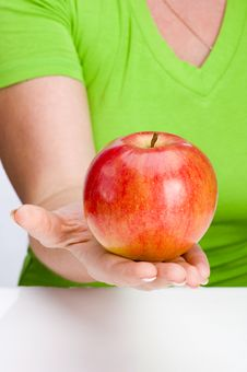 Free Apple In Hand Stock Images - 14741314