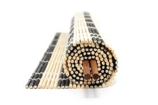 Half-rolled Bamboo Mat With Chopsticks Royalty Free Stock Image