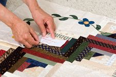 Pinning Label On Quilt Stock Images