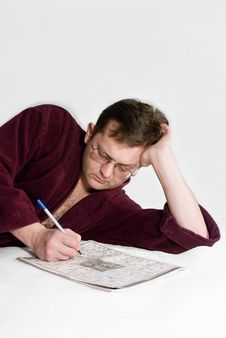 The Man In A Dressing Gown With A Crossword Puzzle Royalty Free Stock Photos