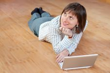 Beautiful Business Woman With A Laptop On Floor Royalty Free Stock Photography