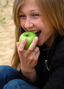Woman Bite Off Green Apple Royalty Free Stock Photography