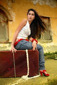 Free Beautiful Model Sitting On Red Suitcase. Stock Photo - 14745530