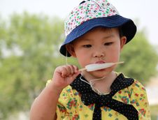 Free Likes Eating The Ice Cream Little Girl Stock Photos - 14747323