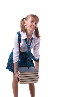 Schoolgirl Is Holding The Stack Of Book. Stock Photo