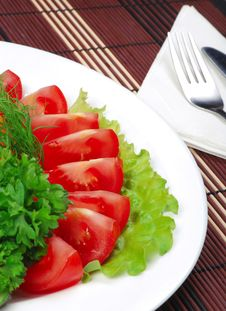 Tomatoes On A Dish Royalty Free Stock Image