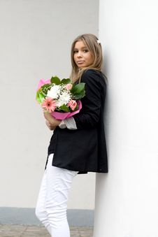 Girl With A Bunch Of Flowers Stock Photos
