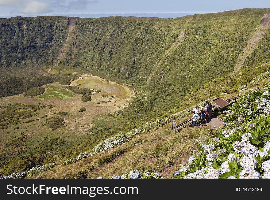 Tourists admiring Caldeira volcano in Faial