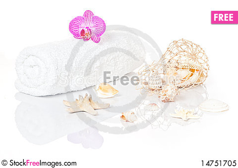 White towel with Orchid an Seashells Stock Photo