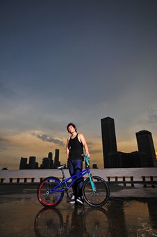 Free Asian Chinese Bicycle Guy Showing His Bike Stock Image - 14752721