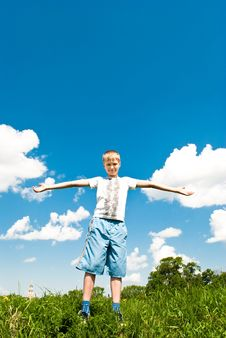 Free A Child On The Grass Against The Blue Sky Royalty Free Stock Photos - 14755458