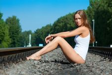 Free Young Woman Sits On Railway Rails Royalty Free Stock Photography - 14755887
