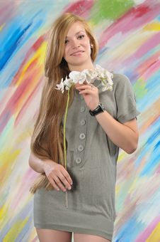 Portrait Of Beautiful Girl With White Orchid Stock Photo
