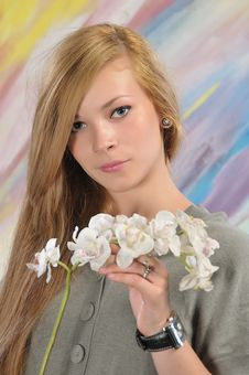 Portrait Of Beautiful Girl With White Orchid Stock Images