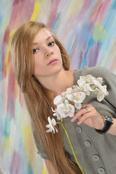 Portrait Of Beautiful Girl With White Orchid Royalty Free Stock Photography