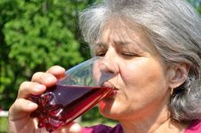 Free Woman Drinks Chilled Cherry Juice Stock Image - 14757381