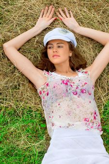 Beautiful Girl In A Meadow Near The Hay Royalty Free Stock Photography