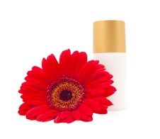 Free Cream Bottle With A Red Gerberas Royalty Free Stock Images - 14758089
