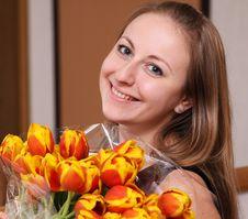 Girl With Tulips Stock Image