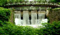 Free Bridge On A Canal Spillway Royalty Free Stock Photo - 14768385