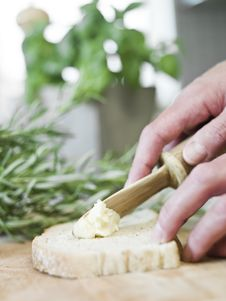 Spreading Butter On Bread Royalty Free Stock Images