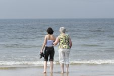 Senior And Adult Woman Looking At The Sea Stock Photo