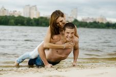 Free Couple On A River Bank Royalty Free Stock Images - 14763399