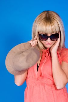 Blonde In Glasses A Blue Background Stock Photos