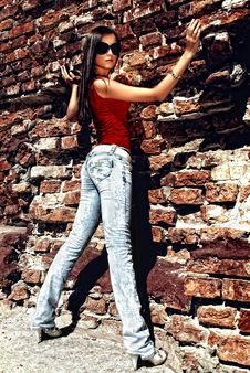 Free Unforgettable Model Standing Near Old Wall. Stock Photos - 14766783