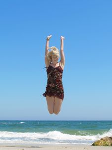 Free Woman Jumping On The Beach Royalty Free Stock Photos - 14767618