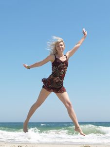 Free Woman Jumping On The Beach Royalty Free Stock Image - 14767636