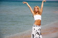 Young Beautiful Woman On Sea Background Stock Photography
