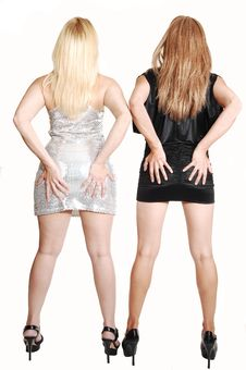 Two Girls Holding There Butt. Royalty Free Stock Photography