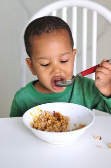 Free Child Eating At Table Royalty Free Stock Photography - 14776417