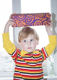 The Boy With A Gift Royalty Free Stock Images