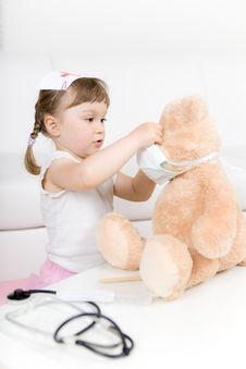 Free Little Girl Doctor With Teddy Bear Royalty Free Stock Photo - 14778215