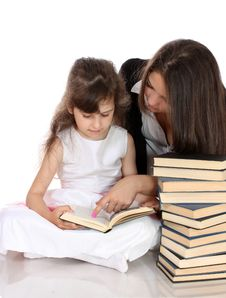 Two Sisters With Books, Isolated. Royalty Free Stock Images