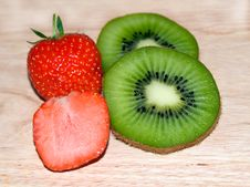 Kiwi Slices And Strawberry Slices Stock Photos