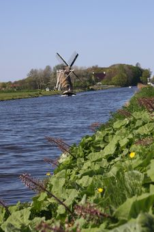 Windmill Alongside Canal. Royalty Free Stock Images