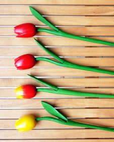 Free Fake Tulips On Wood Background Stock Photo - 14789240