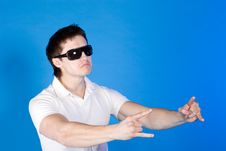 Free Brave Guy In The Studio Against A Blue Background Royalty Free Stock Images - 14791289