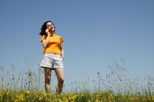 Free Happy Woman Enjoying The Outdoors Using Her Cell P Stock Photos - 14792873