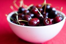 Free Cup With Cherries On Red Background Stock Photos - 14794163
