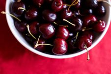 Free Cup With Cherries On Red Background Stock Photos - 14794183