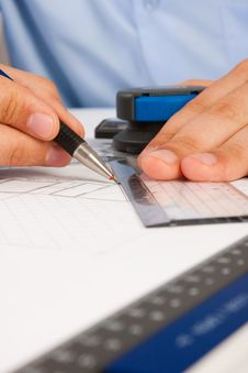 Architect Working On Architectural Plans Stock Photo