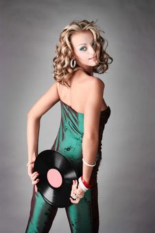 Free Beautiful Girl In Trend Clothes Holding Vinyl Disc Royalty Free Stock Image - 14797216
