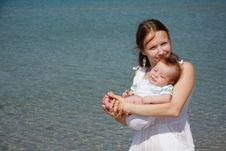 Mother And Baby On Sea Background Stock Photos