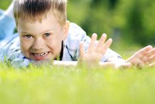 Free Child Lying On The Grass. Stock Photos - 14799883