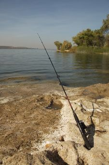 Fishing Pole Alongside A Lake Stock Image