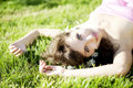 Free Beautiful Girl Lying On The Grass With Flowers Stock Photos - 14800793